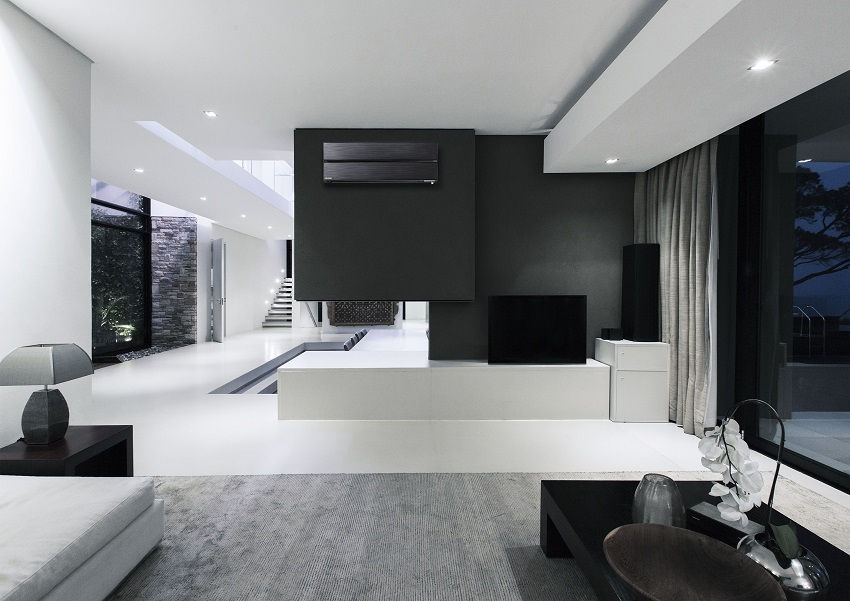 View of fireplace in luxurious living room during night
